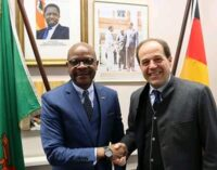Austrian Honarary Consul to Zambia Heinz Messenger confers with Ambassador Anthony Mukwita